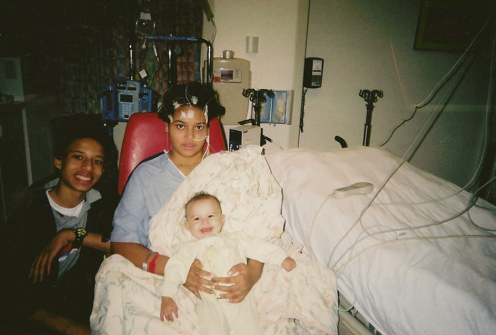 Chaunell in the hospital with Cordell and baby Jameelah